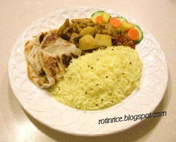 Namesake of my Blog is my very first post on this blog featuring the perennial favorite of my hometown - Chicken Curry and Roti Canai. | RotiNRice.com #firstblogpost #rotinrice #chickencurry #roticanai