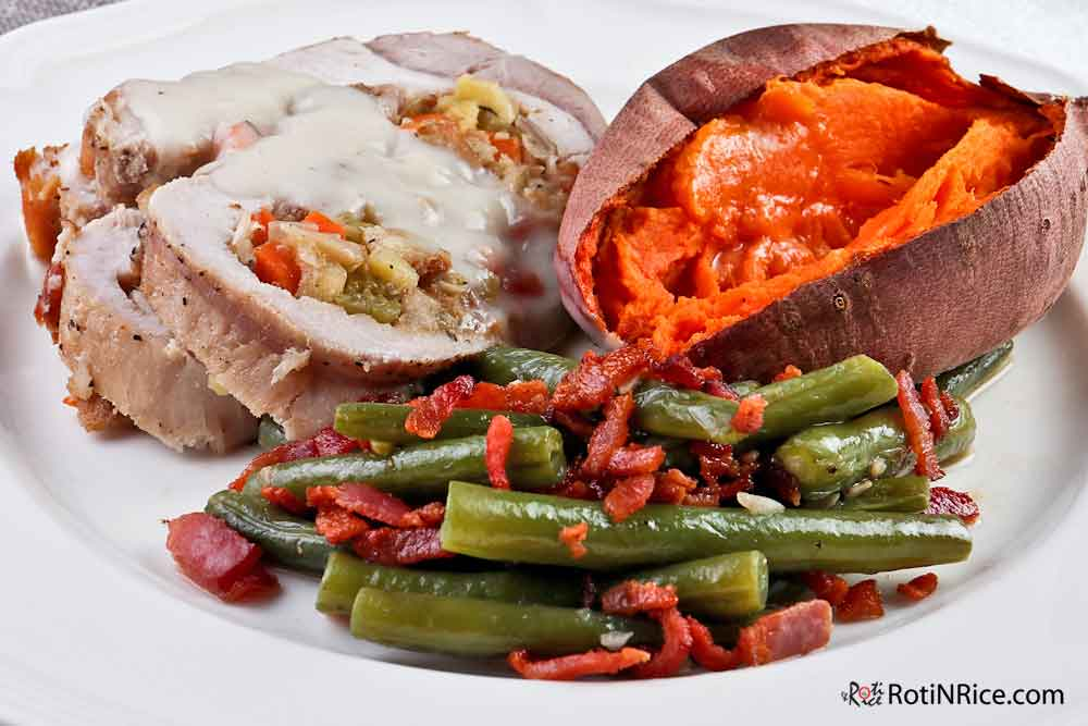 Apple Stuffed Sirloin Roast served with Whole Baked Sweet Potato and Green Beans with Bacon.