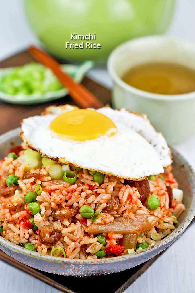 This Kimchi Fried Rice is a delicious way to use up over-ripe kimchi and day old rice. Top with a fried egg for a tasty and satisfying meal. | RotiNRice.com