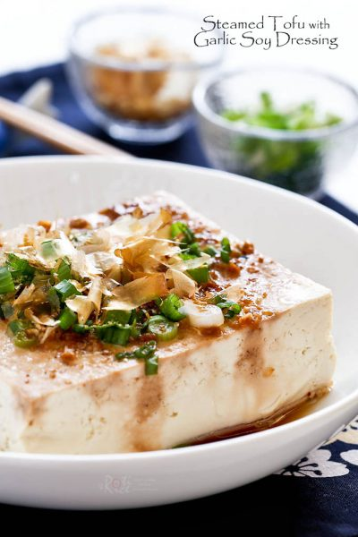 Steamed Tofu with Garlic Soy Dressing served family style placed in the center of the table.