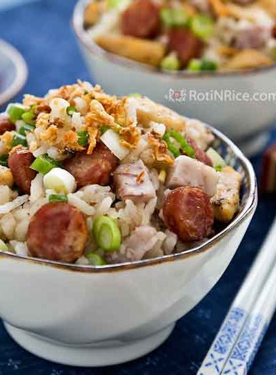 Yam/Taro Rice is a savory one-pot meal made with long grain rice, fluffy taro (a.k.a. yam), chicken, and Chinese sausage. It is deliciously satisfying. | RotiNRice.com #taro #yam #yamrice #onepotmeal