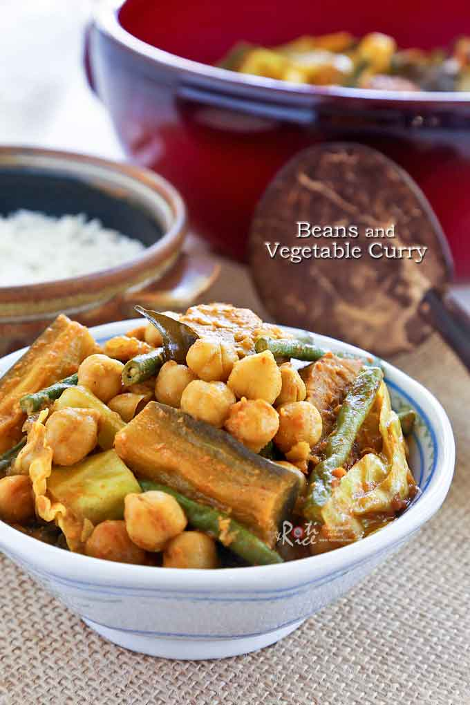 Quick and easy Beans and Vegetable Curry with long beans, chickpeas, tempeh, eggplant, and cabbage. Serve over rice for a delicious vegetarian meal. | RotiNRice.com