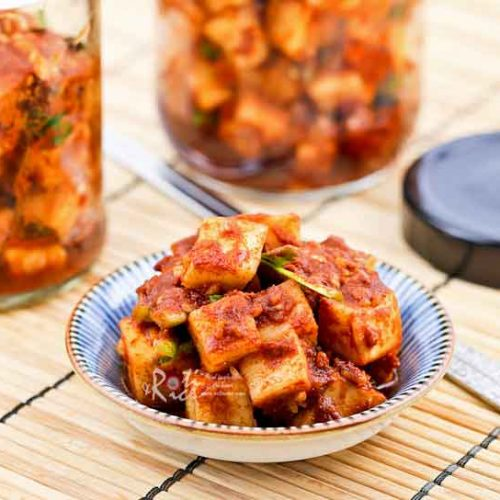 Kkakdugi (Radish Kimchi) is a variety of kimchi made with Korean radish. It is a deliciously spicy and crunchy condiment eaten with steamed rice.   RotiNRice.com