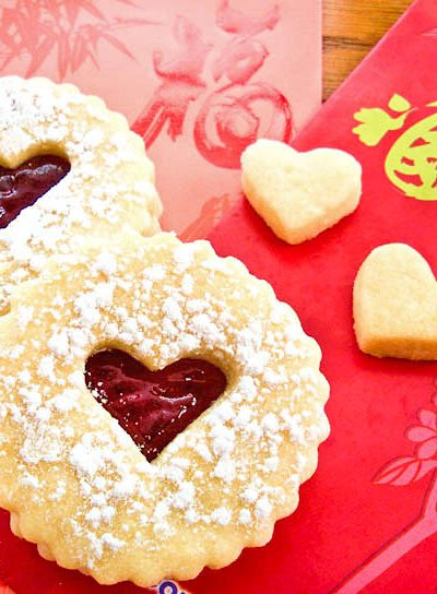 Buttery egg-free Valentine Linzer Cookies with strawberry jam for your sweetie on Valentine's Day. Perfect with a cup of tea. | RotiNRice.com