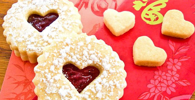 Buttery egg-free Valentine Linzer Cookies with strawberry jam for your sweetie on Valentine's Day. Perfect with a cup of tea.   RotiNRice.com