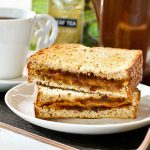 Rich savory Grilled Marmite Cheese Sandwich with lots of umami flavor. Makes a quick and satisfying breakfast or snack served with your favorite cup of tea. | RotiNRice.com #grilledcheesesandwich #grilledcheese #marmite