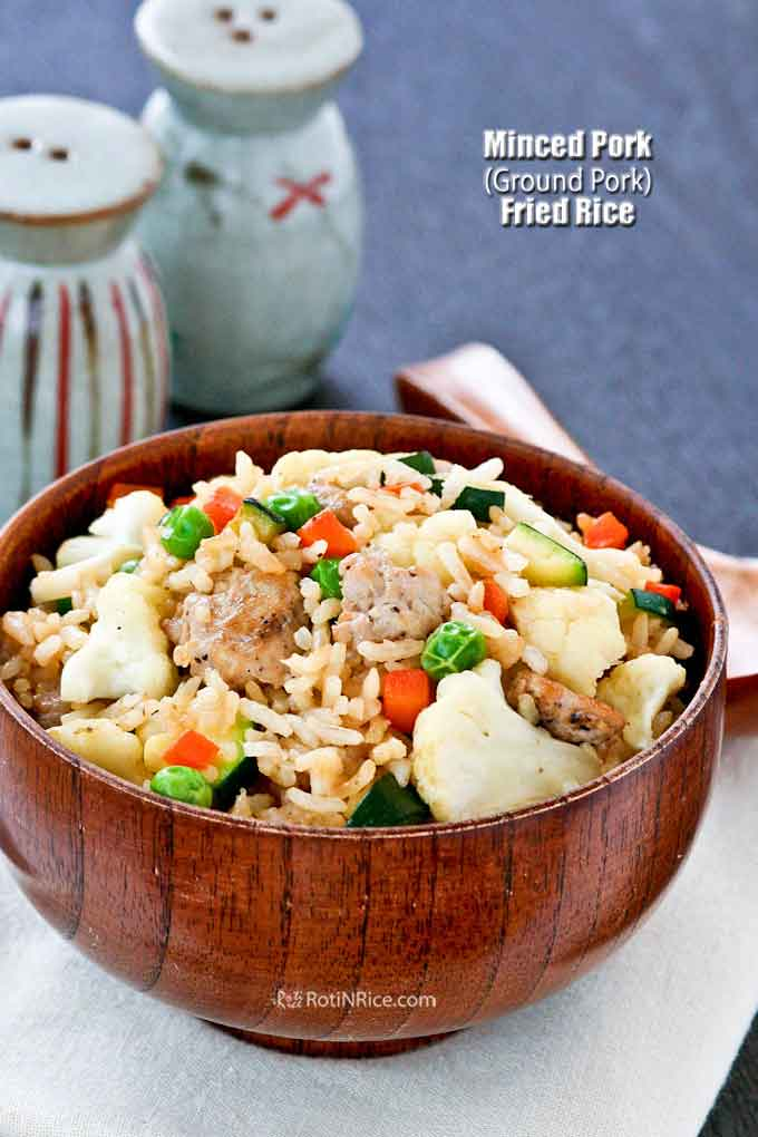 This easy Minced Pork Fried Rice with cauliflower, carrots, zucchini, and green peas will soon be a favorite at your house. Less than 30 minutes to prepare. | RotiNRice.com