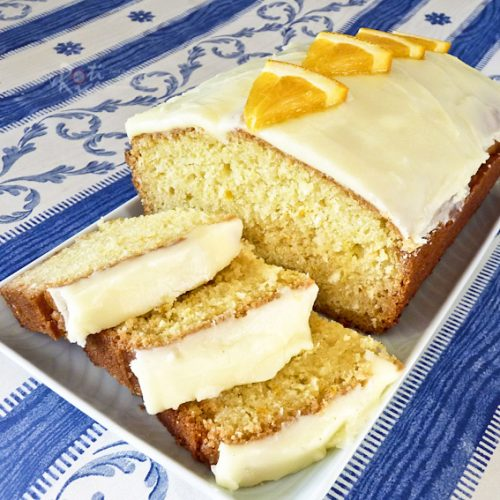 This fragrant and moist Orange Coconut Cake with Orange Frosting is a winner. The flavors of orange and coconut are simply delightful together.   RotiNRice.com