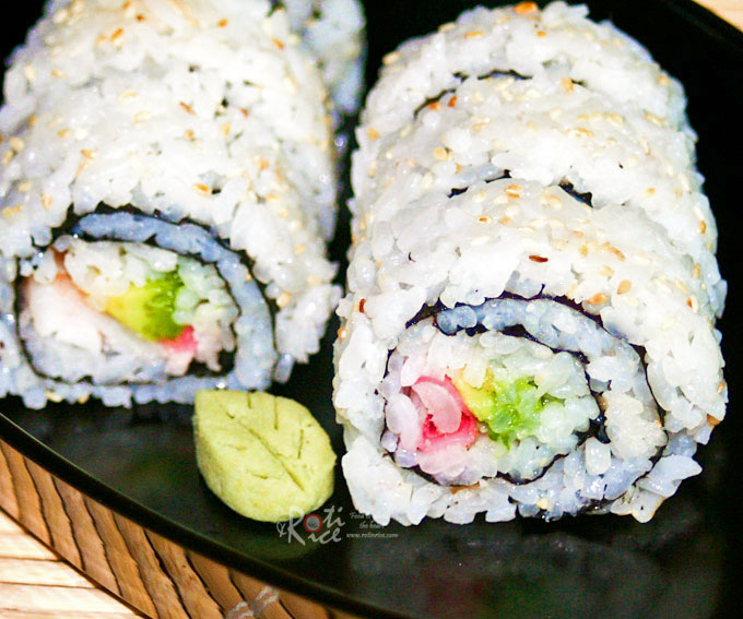 Elegant and delicious Uramaki (Inside-out Roll) with avocado, shrimps, and pickled ginger. Recipe with step-by-step instructions and pictures. | RotiNRice.com