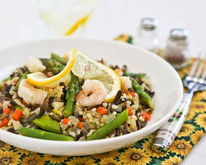 Usher in spring with this light and tasty Warm Asparagus and Wild Rice Salad. It works well as a side dish or a stand-alone light lunch. | RotiNRice.com