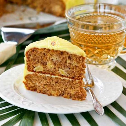Luscious Banana Pineapple Cake with Pineapple Frosting made with ripe bananas and crushed pineapples. It has a deliciously moist and tender crumb. | RotiNrice.com #bananapineapplecake #bananacake #pineapplecake