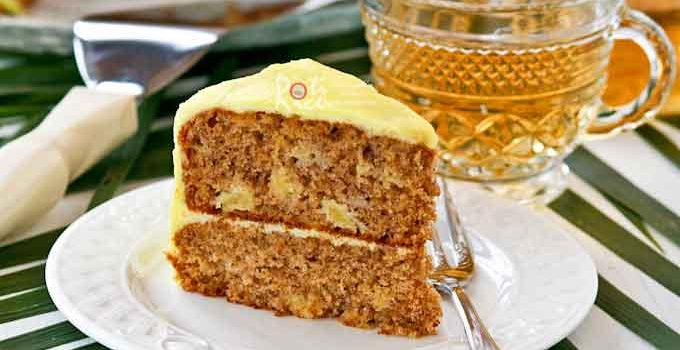 Luscious Banana Pineapple Cake with Pineapple Frosting made with ripe bananas and crushed pineapples. It has a deliciously moist and tender crumb. | RotiNRice.com