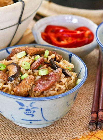 Claypot Chicken Rice is a delicious one-pot meal that can be easily prepared at home. The addition of mushrooms and Chinese sausage makes it even tastier. | RotiNRice.com