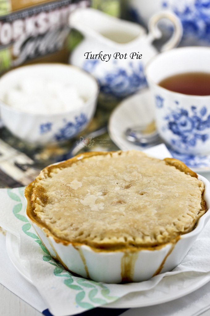 Delicious Turkey Pot Pie with flaky homemade pie crust. Totally freezer friendly. Assemble, freeze, and bake from frozen when desired. | RotiNRice.com