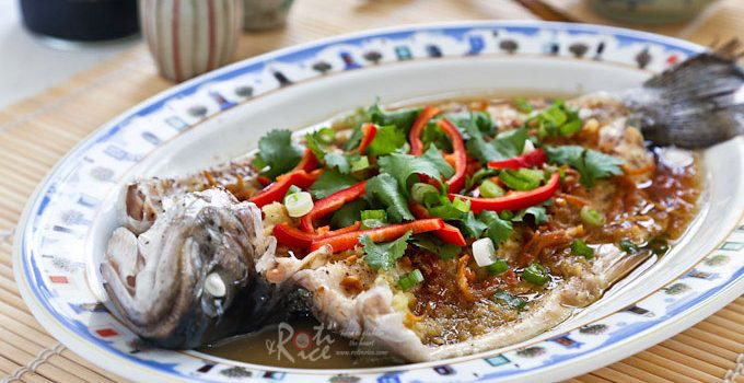 This sweet and tender Steamed Rainbow Trout is quick, healthy, and delicious. It is dressed Chinese style with a simple ginger, garlic, and soy dressing.   RotiNRice.com