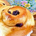 Sweet and sticky Chelsea Buns filled with dried fruits.