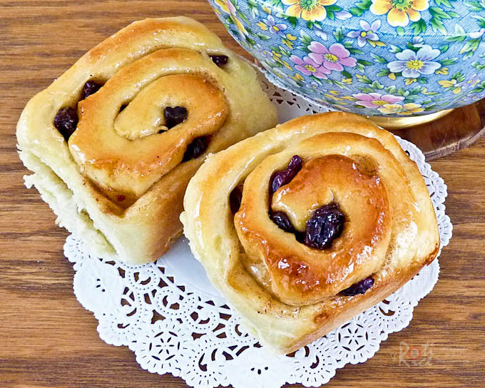 Sweet and sticky Chelsea Buns filled with a mix of spices, raisins, and cranberries. Delicious eaten warm fresh out of the oven. | RotiNRice.com