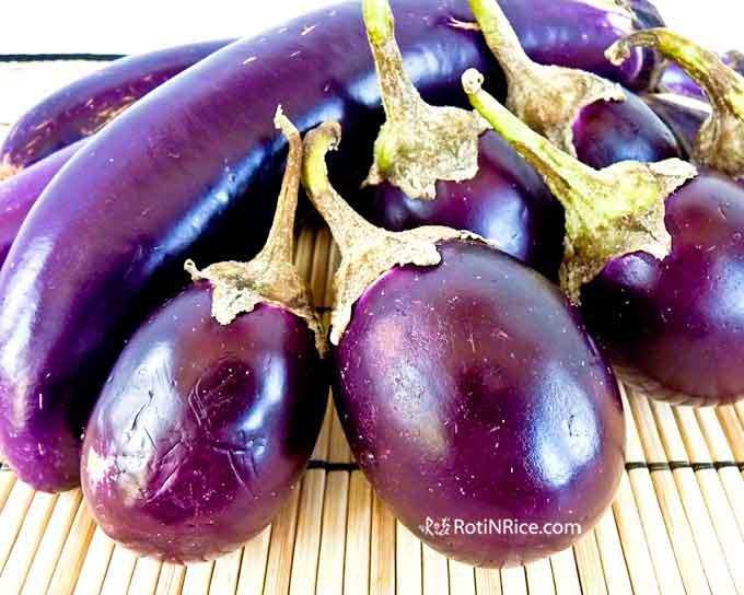 Long Chinese eggplants and round eggplants.