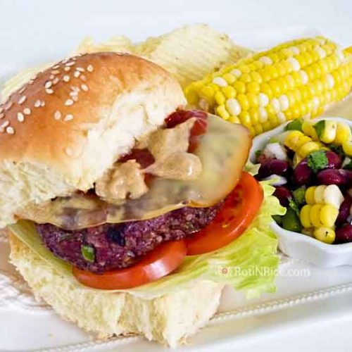 Juicy Homemade Hamburgers made with lean ground beef, chopped green pepper, onion, and soft breadcrumb served with Bean and Corn Salsa. | RotiNRice.com