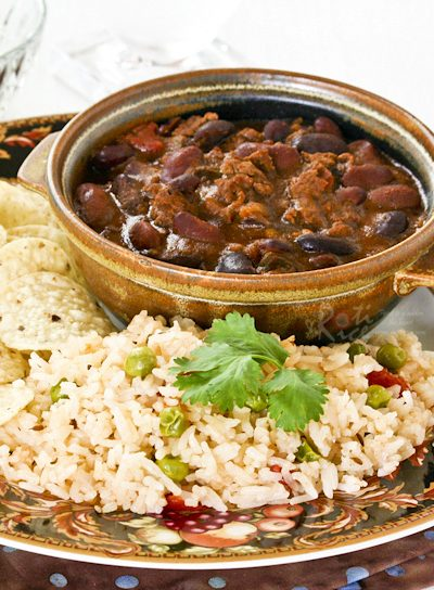 Chili Con Carne is known simply as chili in the US. This version has a secret ingredient to give it a richer flavor. Delicious served with Tomato Rice. | RotiNRice.com