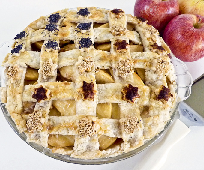 This uniquely delicious lattice crust Apple Pie has a filling of apples layered with a thick caramel-like sauce. It is a must-try! | RotiNRice.com