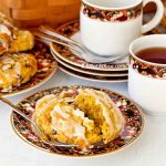 Usher in fall/autumn with these delightfully spiced Pumpkin Cranberry Scones. They are also delicious served with butter, jam, and whipped cream. | RotiNRice.com #scones #sconerecipes #pumpkinrecipes #cranberryrecipes