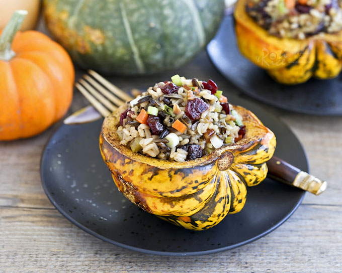 This fall favorite Cranberry Wild Rice Stuffed Squash is festive and flavorful. It is delicious served as a main course or side dish. | RotiNRice.com