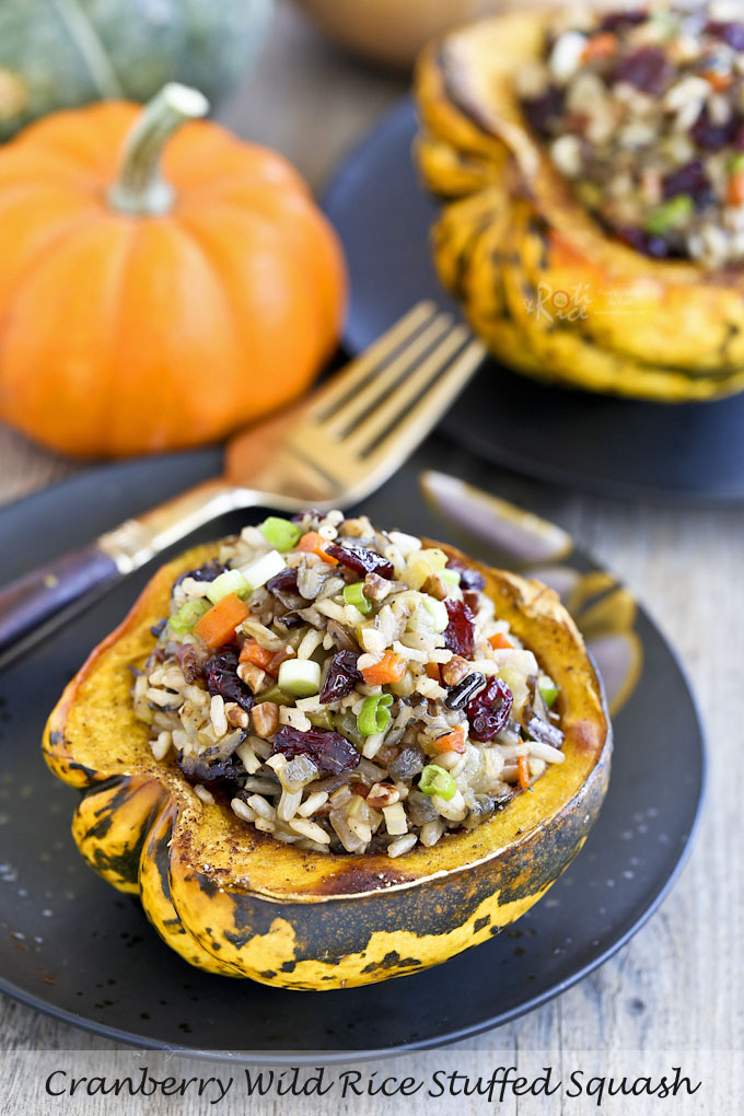 This fall favorite Cranberry Wild Rice Stuffed Squash is festive and flavorful. It is delicious served as a main course or side dish. | Food to gladden the heart at RotiNRice.com