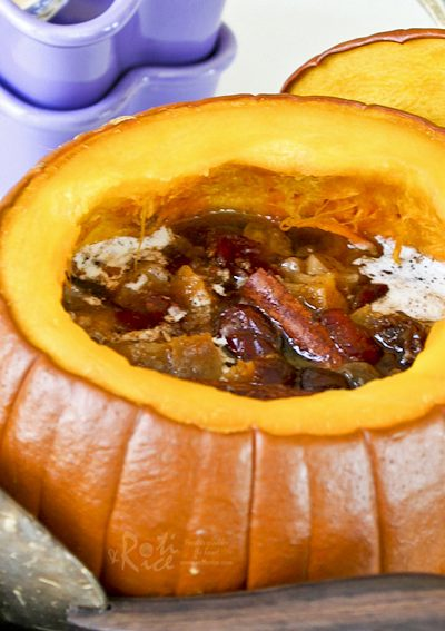 Impress family and friends with this hollowed out Sweet Stuffed Pumpkin dessert filled with mixed dried fruits and spices. It is warm, delicious, and perfect for the holidays.   RotiNRice.com #pumpkin #pumpkinrecipes #Thanksgivingrecipes