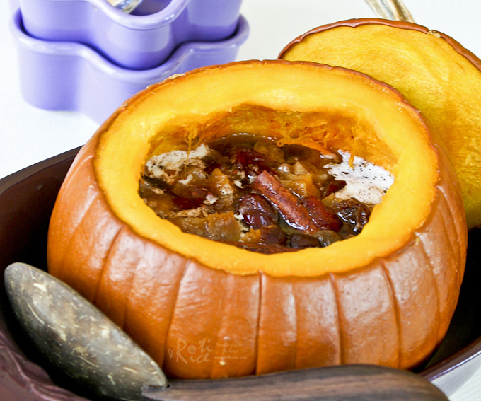 Impress family and friends with this hollowed out Sweet Stuffed Pumpkin dessert filled with mixed dried fruits and spices. It is warm, delicious, and perfect for the holidays. | RotiNRice.com #pumpkin #pumpkinrecipes #Thanksgivingrecipes