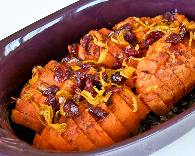 Candied Sweet Potatoes with dried cranberries and orange zest moistened with freshly squeezed orange juice. A must-have for Thanksgiving or any holiday! | RotiNRice.com