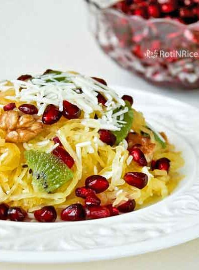 Tutti-frutti Spa-ghetti - a tasty salad with an unusual combination of spaghetti squash, kiwi fruit, pomegranate, walnuts, and shaved parmesan cheese. | RotiNRice.com