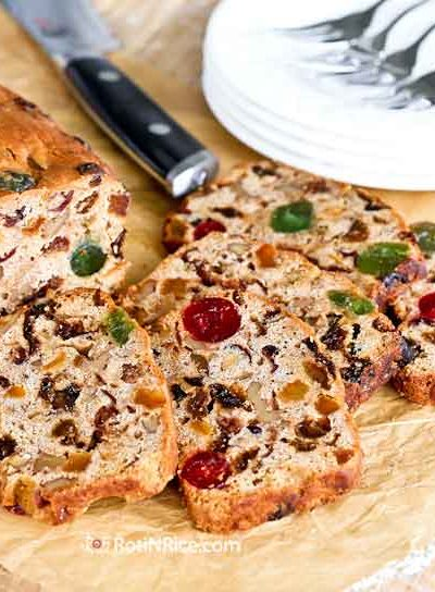 Warmly spiced traditional Rich Fruit Cake studded with dried fruits and nuts. Layers of brandy and sherry keep it moist and flavorful. | RotiNRice.com #fruitcake #christmascake #christmasrecipes