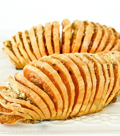 These Hasselback Sweet Potatoes are a simple yet elegant and tasty side dish for your holiday table. Recipe includes a savory and sweet toppings.   RotiNRice.com