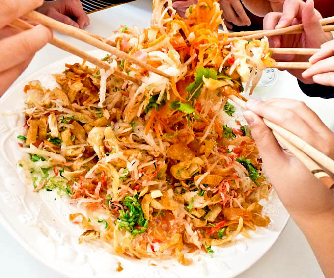 The fun part of tossing the Yee Sang.