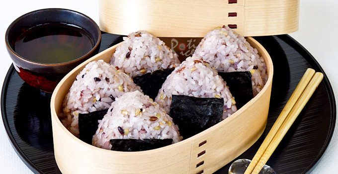 Mixed Grain Onigiri with rice, red rice, black rice, sticky rice, millet, amaranth, quinoa, barley, oats, and sesame seeds. Very tasty and satisfying.   RotiNRice.com