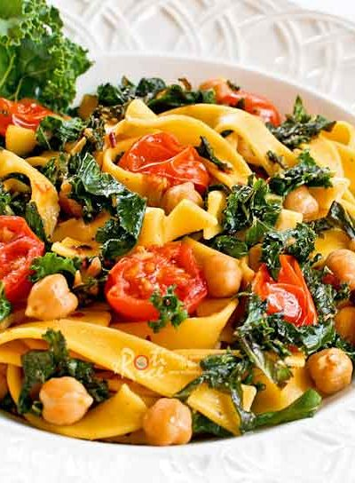 Healthy and delicious Fettuccini with Kale, Chickpeas, and Tomatoes lightly flavored with garlic, pepper flakes, and lemon juice. | RotiNRice.com