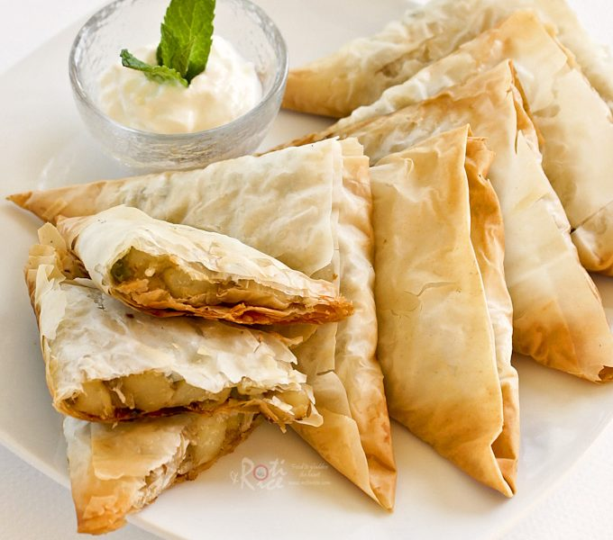 Easy baked Vegetable Samosas using filo pastry and a mildly spiced potato and green peas filling. Great as an afternoon snack or tea time treat.   RotiNRice.com