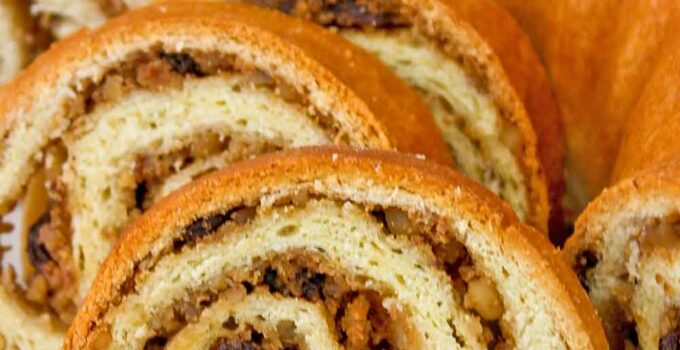 Potica (Slovenian Nut Roll), a delicious celebratory bread resembling a jelly roll made of very thinly rolled yeast dough spread with a nut paste. | RotiNRice.com