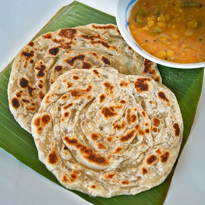 Crispy and fluffy homemade Roti Canai (Roti Paratha) with step-by-step instructions. Delicious eaten with dhal and chicken curry. | RotiNrice.com #roticanai #rotiparatha #rotipratha #indianflatbread