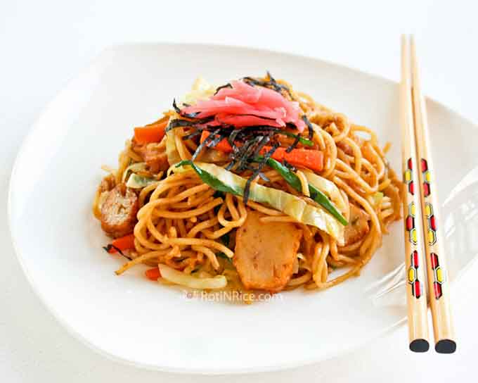 Quick and easy Yakisoba (Japanese Stir Fried Noodles) with fish cakes, onions, carrots, and cabbage. Makes a delicious and satisfying meal. | RotiNRice.com