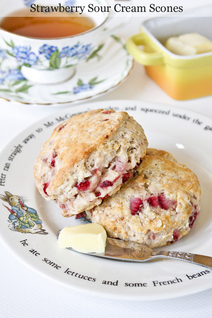 Delicious scones served with butter and tea.