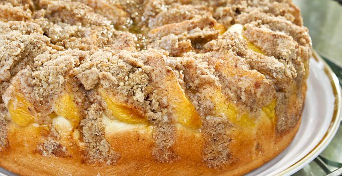 Peach Streusel Kuchen - a bread-like coffee cake with a fine and dense texture topped with fresh peaches and cinnamon almond streusel. | RotiNRice.com