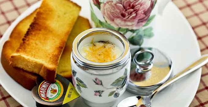 Merry Olde England and tender Coddled Eggs garnished with cooked ham, parsley, and cheese in beautiful ceramic egg coddlers. Such a treat! | RotinRice.com