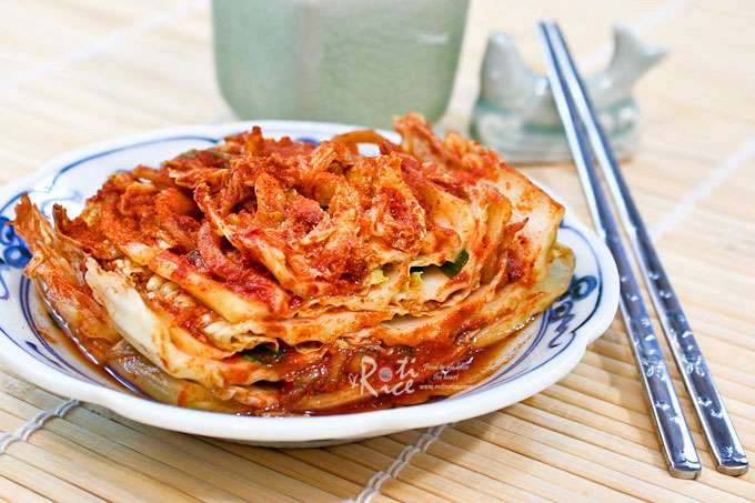 Once you make your own Napa Cabbage Kimchi (Poggi Kimchi), you will never go back to store bought. Homemade kimchi tastes so much better and fresher.   RotiNRice.com