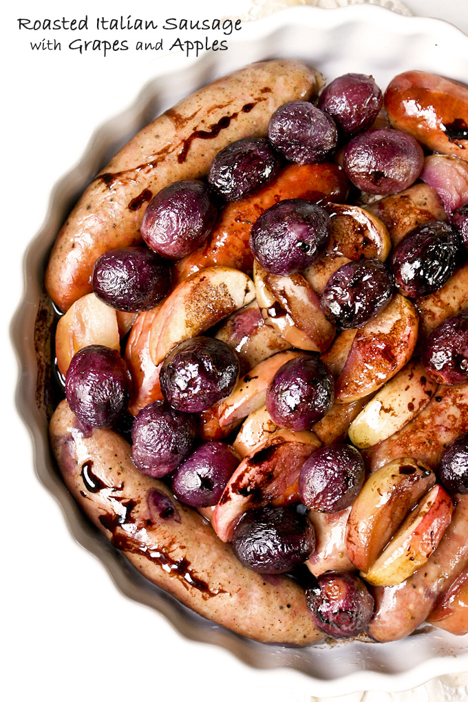 This Roasted Italian Sausage with Grapes and Apples with a balsamic vinegar and red wine reduction sauce is sure to please. Delicious with mashed potatoes. | RotiNRice.com