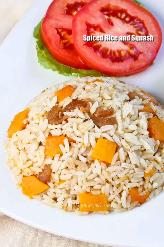 Spiced Rice and Squash served with lettuce and slices of tomatoes.