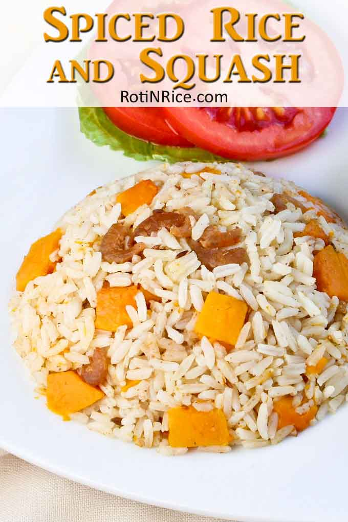 spiced rice served with lettuce and slices of tomato.
