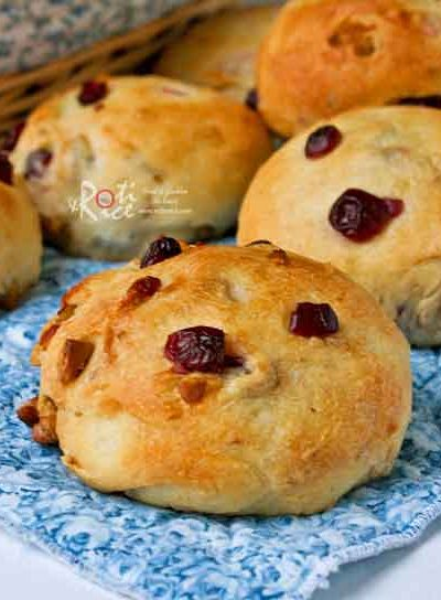 These tasty and beautiful Cranberry Walnut Rolls are delicious served warm with butter for breakfast or the holiday table. | RotiNRice.com #cranberryrolls #dinnerrolls #thanksgivingrecipes #christmasrecipes #walnuts