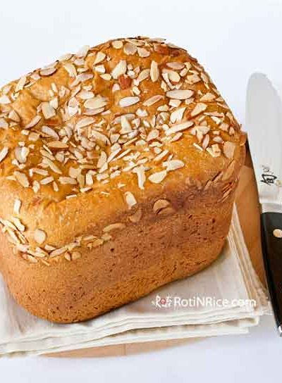 Easy bread machine Sweet Potato Yeast Bread with a tender crumb and golden color topped with sliced almonds. Makes a great sandwich bread. | RotiNrice.com #sweetpotatobread #yeastbread #breadmachine